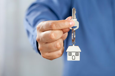 Our property manager will hand a qualified tenant their new keys